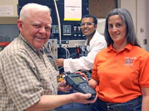 From left, Tom Davis, Ph.D., doctoral student Alemayehu Yetayew and Malynda Cappelle are developing a method to make water desalination more affordable and efficient. Photo by Laura Trejo / UTEP News Service