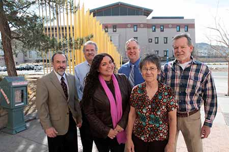 UTEP's Returned Peace Corps Volunteers have teamed up to promote the mission and benefits of the Peace Corps at the University. They include, from left, Gary Frankwick, Arturo Pacheco, Pamela Cruz, Robert Trussell, Kathy Staudt, and Jon Amaste. Cruz is a political science graduate student and the others are UTEP professors. Photo by J.R. Hernandez / UTEP News Service