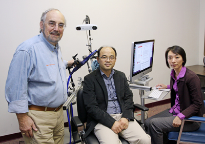 Anthony Salvatore, Ph.D., chair of the Department of Rehabilitation Sciences at UTEP, and postdoctoral fellows Chu-Ling Lo, Ph.D., and Kyoung Yuel Lim, Ph.D., are using a transcranial magnetic simulation device to treat concussions. Lo and Lim are participating in a yearlong training program that prepares postdoctoral fellows to conduct TBI research. Photo by Laura Trejo / UTEP News Service