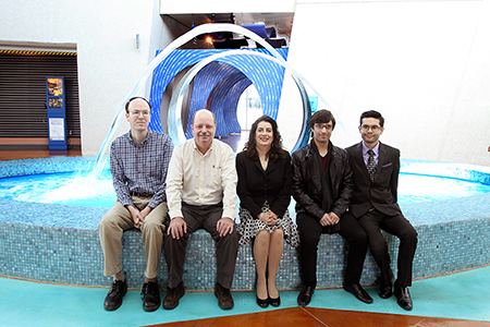 Marcela Navarrete, El Paso Water Utilities vice president of strategic, financial and management services, center, sits with a UTEP team that will examine the commonalities of water usage among municipal water utilities around the world. They are, from left, Adam Walke, research associate; Tom Fullerton, Ph.D., professor of economics; and graduate students Alex Ceballos and Alan Jimenez. Photo by Laura Trejo / UTEP News Service