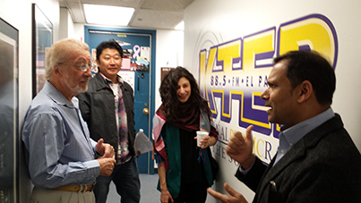 "KTEP-FM (88.5) host Keith Pannell, Ph.D., left, mingles with his guests at a break during the taping of ""100@ 100: Research for Our Next Century"" inside Cotton Memorial. His guests were Hideaki Tsutsui, assistant professor of theatre and dance; Andrea Shaheen, D.M.A., assistant professor of music; and Arvind Singhal, Ph.D., professor of communication. Photo by Daniel Perez / UTEP News Service"