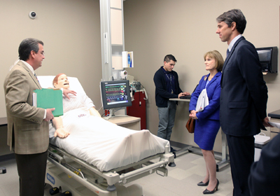 Ronnie Stout, director of UTEP's Center for Simulation, shows Mary Wakefield, Ph.D, and Rep. Beto O'Rourke one of the simulation mannequins that nursing students use to practice their skills in the simulation lab. Photo by Laura Trejo / UTEP News Service