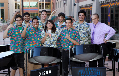 Larry Murr, Ph.D., professor of metallurgical and materials science, stands with members of the Pantastics steel drum show band, which performed April 10, 2014, in the Engineering Building courtyard. Photo by Ivan Pierre Aguirre / UTEP News Service
