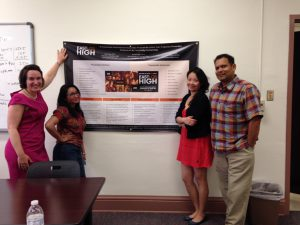 "UTEP faculty and students with a presentation announcing initial results of their study on transmedia TV series ""East Los High."" From left to right: UTEP Project Coordinator Carliene Quist, M.S.W.; Anu Sachdev, master's degree candidate in UTEP's Department of Communication; Principal Investigator Hua (Helen) Wang, Ph.D., University at Buffalo, The State University of New York; and Principal Investigator Arvind Singhal, Ph.D. professor of Communication at UTEP. Photo courtesy of the ""East Los High"" Research Project."