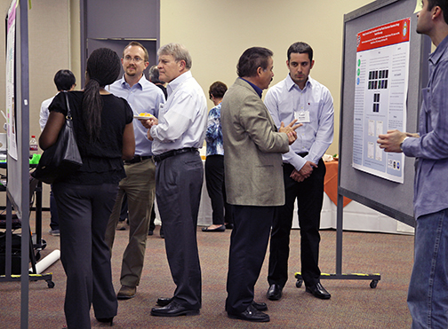 Researchers explain their posters at the 2014 UTEP IDR Symposium in April. Photo courtesy of Andrea Tirres.