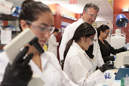 UTEP students work inside the cutting-edge laboratories of the Border Biomedical Research Center alongside experts such as Robert Kirken, Ph.D., center. Photo by J.R. Hernandez / UTEP News Service