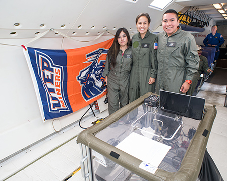From left, UTEP students Miriam Paez, Sara Soto and Gabriel Garay pose before their reduced gravity flight experiments commence, which took place on July 14 in Ellington Field at NASA's Johnson Space Center. Photo courtesy of NASA