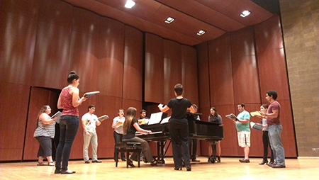 The UTEP students who make up the chorus in Opera Bhutan rehearse with chorus master Elisa Fraser Wilson, D.M.A., at the Fox Fine Arts Recital Hall in preparation for the Aug. 30 performance. Photo by Lisa Y. Garibay / UTEP News Service.