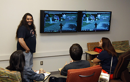 Steve Varela, associate director of Academic Technologies, uses gaming methods to encourage learning during a summer course for incoming freshmen. Photo by Ivan Pierre Aguirre