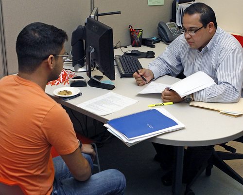College of Liberal Arts Career Adviser Daniel Cereceres meets with a student inside CLASS, the college's Student Success Center which is part of a broad Student Success Initiative. Photo by Ivan Pierre Aguirre / UTEP News Service