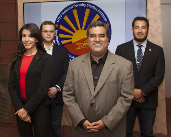 UTEP's Intelligence and National Security Studies program expects to rebrand itself and enhance its academic and research capabilities because of a $1.9 million grant from the U.S. Intelligence Community. Representing UTEP's program are, from left, Lisa Saenz, program coordinator; Sean Curtis, graduate student; Larry Valero, Ph.D., program director; and Kevin Thompson, graduate assistant.