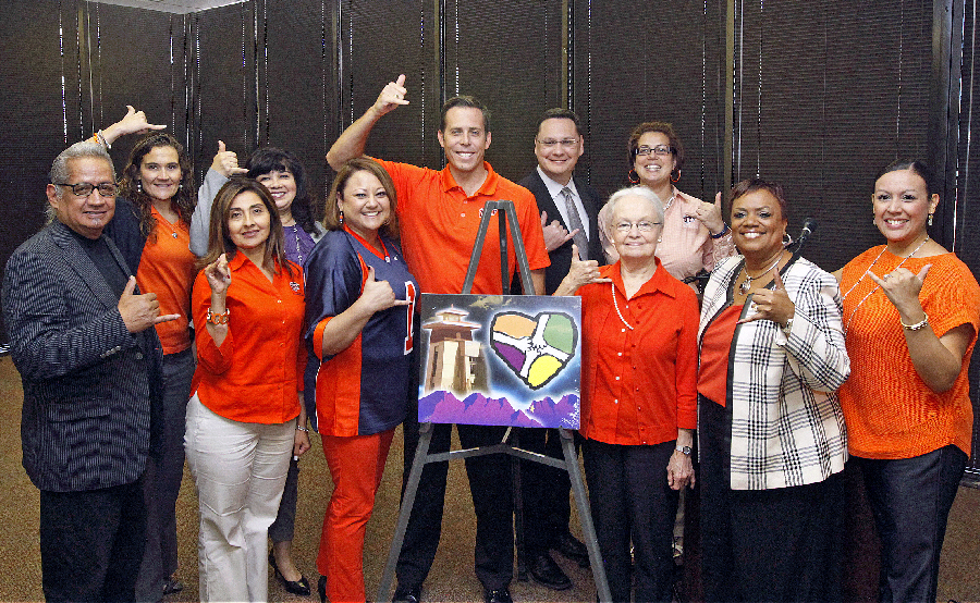 UTEP President Diana Natalicio (right of the painting) poses with members of UTEP's 2014 SECC Committee. This year's goal is to raise $100,000 during the campaign. Photo by Ivan P. Aguirre / UTEP News Service