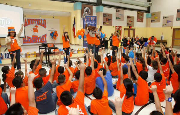 """Schoolchildren join Paydirt Pete in a """"Picks Up"""" gesture as part of the UTEP Celebrates event that happened Friday, Oct. 3. Photo by UTEP News Service"""