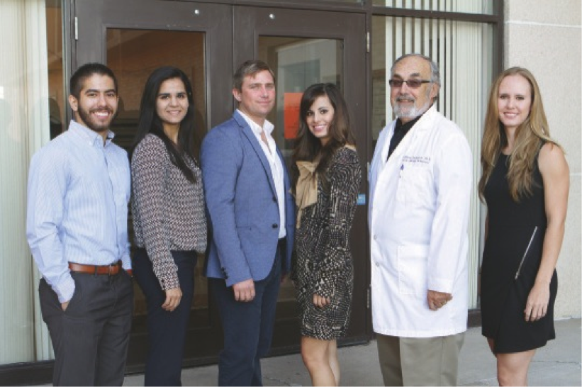 In UTEP's Concussion Management Clinic, graduate student researchers in speech-language pathology, from left, Daniel Schobner, Paulina Mejia, John Pfirman, Kara Greco, clinic director Anthony P. Salvatore, Ph.D., and Kylie Marshall, are researching traumatic brain injuries in order to treat, prevent and manage concussions in high school and college athletes.