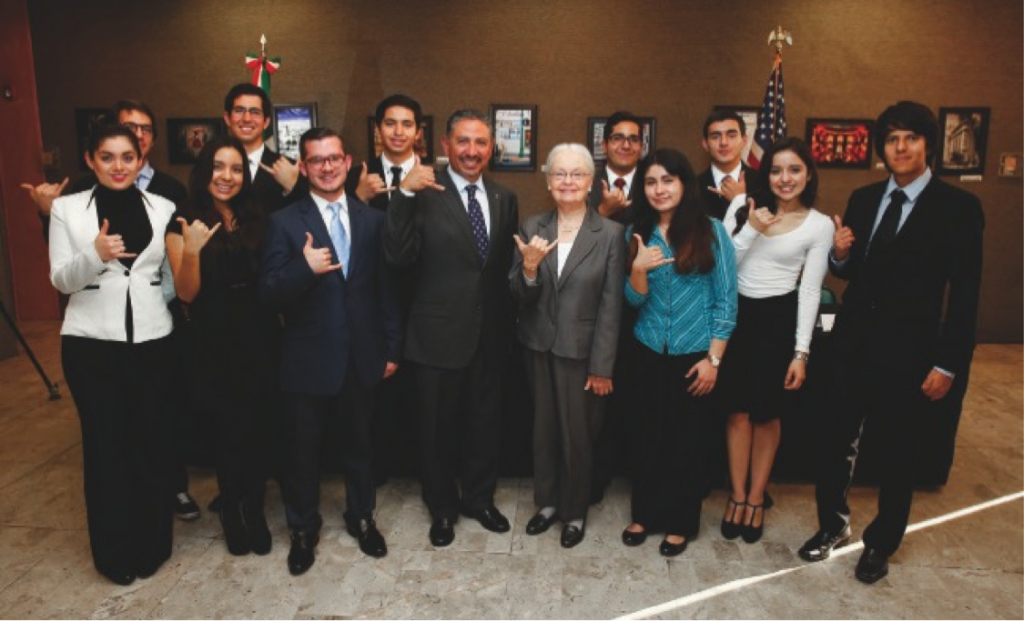 Top: On Dec. 11, 2014, UTEP President Diana Natalicio and Jacob Prado, Consul General of Mexico in El Paso, presented 17 students from Mexico a scholarship from the IME Becas Scholarship Program to study at UTEP.