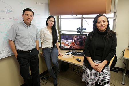 Members of the Vision and Learning Lab, including Olac Fuentes, Ph.D., associate professor of computer science, undergraduate Juanita Ordoñez, and doctoral student Maria Jimenez, are studying how to recognize emotion through facial skin color. Photo by J.R. Hernandez / UTEP News Service