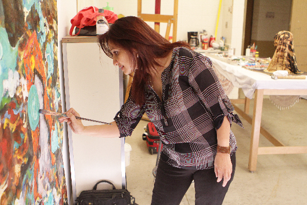 Painter Roya Mansourkhani is serving as the artist-in-residence this academic year for UTEP's Department of Art. Photo by J.R. Hernandez / UTEP News Service