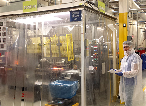 Senior industrial engineering student Eloy Deras walks CareFusion's manufacturing production line. Deras is working to improve the line's efficiency with his technical engineering skills. Photo courtesy of Eloy Deras.