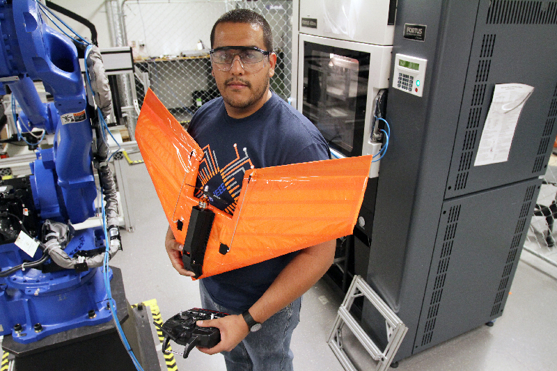 Efrain Aguilera, who just earned a B.S. in electrical and computer engineering, has been creating an unmanned aerial vehicle, or UAV, with 3-D printed electronics in UTEP's W.M. Keck Center for 3-D Innovation. Photo by J.R. Hernandez / UTEP News Service