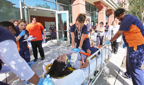 UTEP nursing student Courtney Valenzuela performs chest compressions on an actor playing the role of an injured patient during a simulation exercise at UTEP Aug. 12. Photo by Laura Trejo / UTEP News Service