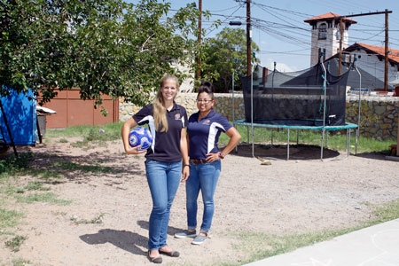 Kiersten Garrand, left, and Amber Flores, students in the Doctor of Physical Therapy Program at UTEP, are raising money to install a soccer field at La Posada Home, a homeless shelter for women and children in downtown El Paso. Garrand is collaborating in a study to identify how physical therapy educators in the United States educate students about patients with disabilities. Photo by Laura Trejo / UTEP News Service