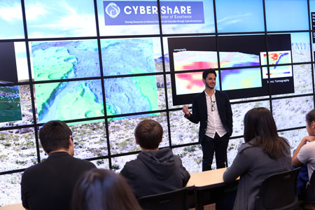 "Some of the region's early college high school students attended a Nov. 13, 2015, presentation by doctoral student Richard Alfaro-Diaz at The University of Texas at El Paso's Cyber-ShARE Center of Excellence Collaborative Visualization System, better known as the ""Viz Wall."" Photo by J.R. Hernandez / UTEP Communications"