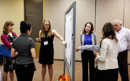 Students and faculty share research presentations during the 2015 IDR Symposium. Photo by Ivan Pierre Aguirre / UTEP Communications.
