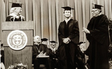 Gary Massingill receives the first doctoral degree awarded at UTEP in 1979.