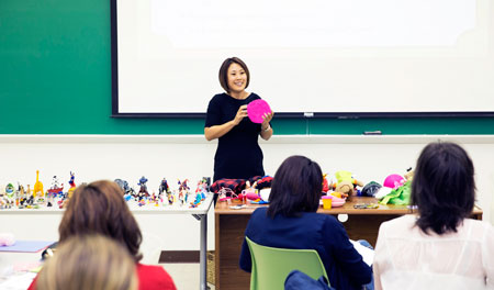 Sang Min Shin, Ph.D., assistant professor of counseling, trains a group of elementary school counselors on child-centered play therapy techniques inside UTEP's Education Building. Photo by Ivan Pierre Aguirre / UTEP Communications