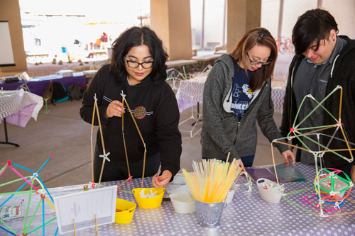 Student members of the Society of Women Engineers hold a competition to make mechanical structures using straws during UTEP E-Week, an annual event celebrating National Engineers Week. Photo by Ivan Pierre Aguirre / UTEP Communications