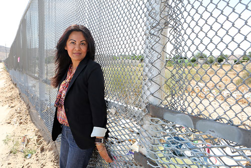 Gabriella E. Sanchez, Ph.D., assistant professor of security studies in UTEP's National Security Studies Institute, studies the social organization of human smuggling groups. Photo by J.R. Hernandez / UTEP Communications