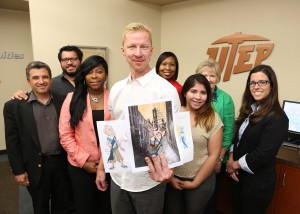 Nate Robinson and his team accompanied by NASA representatives and evaluators. He is holding a handful of story characters created for their project. Photo: JR Hernandez, UTEP Communications