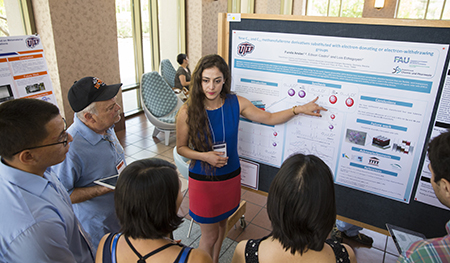 A student presents her poster during the COURI Summer Symposium in the UGLC. Photo by Ivan Pierre Aguirre/UTEP Communications