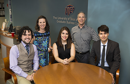 UTEP students, seated from left, Jorge Martinez, Daniela Noriega and Zach Jackson are the first to earn BS/MBA participants to earn their graduate degrees. The trio earned their undergraduate degrees in engineering in 2015. The program was started by Laura Uribarri, assistant dean for academic programs for the College of Business Administration, and David Novick, Ph.D., Mike Loya Distinguished Chair in Engineering and professor of computer science.  Photo by Ivan Pierre Aguirre/UTEP Communications