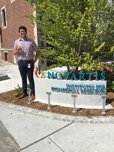 Edmundo Esparza is seen outside the Novartis Institute for Biomedical Research (NIBR) in Cambridge, Massachusetts. Esparza was an intern there over the summer.  Photo courtesy of Edmundo Esparza