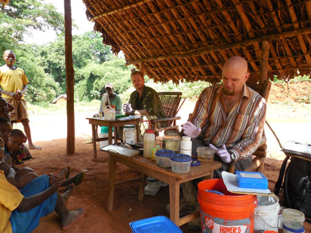 Ph.D. candidate Daniel Hughes, left, and Associate Professor of Biological Sciences Eli Greenbaum, Ph.D., work to preserve rare animal specimens in a remote village of northeastern Democratic Republic of the Congo. Photo courtesy of Eli Greenbaum.