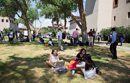 Students congregate outside the UTEP Library. Photo by Ivan Pierre Aguirre / UTEP Communications