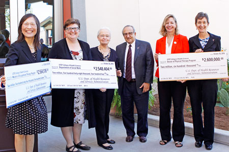 UTEP's occupational therapy, physical therapy and social work graduate programs each will receive more than $2.5 million from HRSA's Scholarships for Disadvantaged Students program to fund scholarships for underrepresented minority students with financial need. Accepting the checks are, from left, Christine Chen, Sc.D., Master of Occupational Therapy program director; Kathryn Schmidt, Ph.D., social work assistant professor; UTEP President Diana Natalicio; Osama Mikhail, Ph.D., College of Health Sciences interim dean; Loretta Dillon, DPT, interim Doctor of Physical Therapy program director; and Celia Pechak, Ph.D., interim Doctor of Physical Therapy associate program director. Photo by Laura Trejo / UTEP Communications