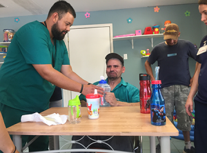 Saul Tercero, left, works at Fundacion Integra, located in Juárez, Mexico. Fundacion Integra is a clinic that serves underprivileged communities in Juárez and offers rehabilitation services to its patients. Photo courtesy of Saul Tercero