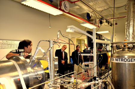 Archive photo of a prior DOE visit to the mechanical engineering labs.  From left to right: Abraham Trujillo, former graduate student in mechanical engineering (now employed at Blue Origin); Regis Conrad, director of the Division of Crosscutting Research at the U.S. Department of Energy's Office of Fossil Energy; Ahsan Choudhuri, Ph.D., chair of UTEP's Department of Mechanical Engineering; and Robert R. Romanosky, Ph.D., technology manager for Crosscutting Research and Analysis at the U.S. Department of Energy's National Energy Technology Laboratory.