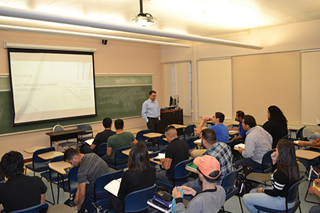 UTEP Assistant Professor of Civil Engineering Reza Ashtiani, Ph.D., teaches a class using a module developed by Ashtiani and R. Joseph Rodríguez, Ph.D., an assistant professor in the Department of English.   Photo courtesy of the UTEP College of Engineering