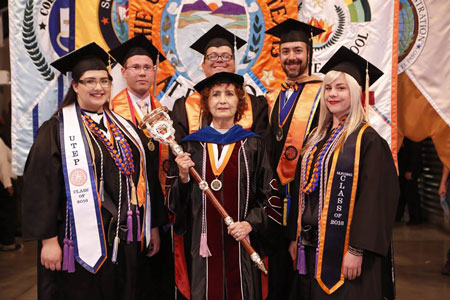 Grand Marshal Helen M. Castillo, center, poses with the banner bearers for the 2 p.m. Winter Commencement ceremony celebrating the colleges of Business Administration and Education and the School of Nursing. Photo by J.R. Hernandez / UTEP Communications