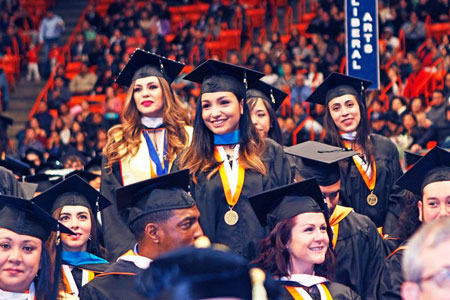 Graduates from the College of Liberal Arts stand to be recognized. Photo by Laura Trejo / UTEP Communications